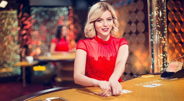 blond-baccarat-girl-Table Games